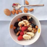 Overnight porridge with berries, almonds, nuts and chocolate