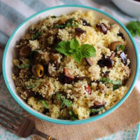 Cous cous with eggplant, tagliasche olives and mint