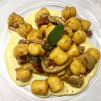 Pumpkin gnocchi with porcini, speck and fondue mushrooms