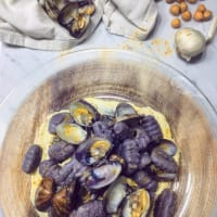 Purple potato dumplings, clams and cream of chickpeas