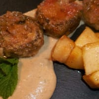 Champignon mushrooms stuffed with gorgonzola and nuts