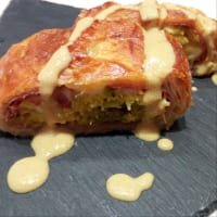Savory strudel of cabbage and speck with mustard sauce