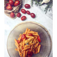 Pasta with lentil flour, cherry tomatoes and mushrooms