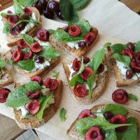 Crostini with tzatziki and cherries