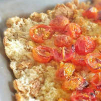 Focaccia of stale bread with cherry tomatoes