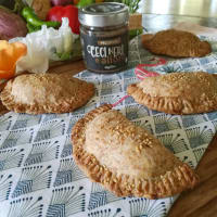 Empanadas with mixed vegetables and creamy black chickpeas and bay leaves