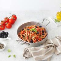 Tummyia busiate with cherry tomato, lilliput capers and olives