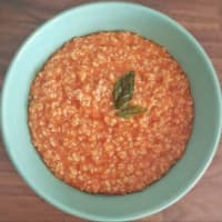 Porridge with tomato sauce and basil