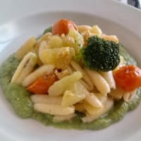 Sardinian Gnocchetti With Potatoes And Cherry Tomatoes On Broccoli Cream