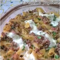Baked pasta with pancetta and bechamel ground beef