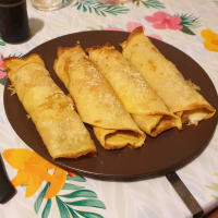 Rolls of speck crepes and fontal