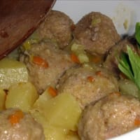 Stewed meatballs with potatoes and carrots