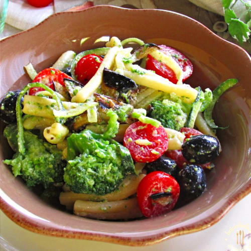 Pasta salad with vegetables, Robiola cheese and black olives
