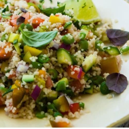 Cous cous with vegetables and sesame sauce