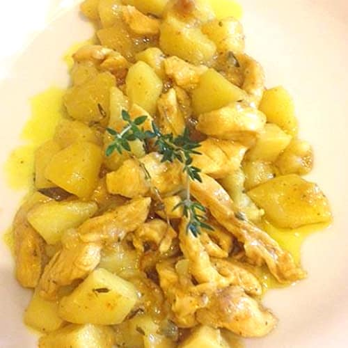 Sliced chicken and potato curry and thyme