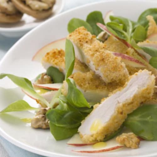 Salad of apples, roasted nuts, corn salad and not crispy fried chicken