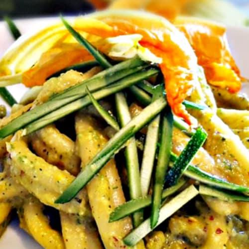Pasta with pesto zucchini almond