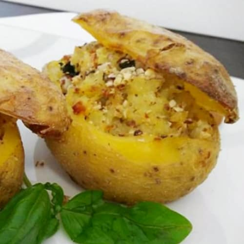 Stuffed potatoes in chopped almonds