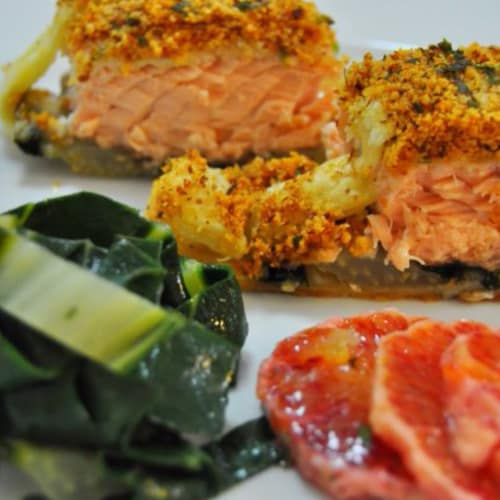 Crusted salmon spiced almonds on bed of chard