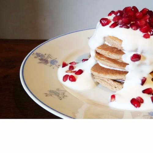 Pancakes with greek yogurt and pomegranate seeds