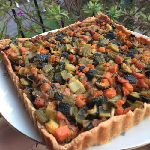 Savory pie with parmesan cheese with vegetables and ham