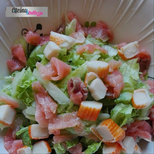 Green salad with surimi and salmon. Very fresh and light