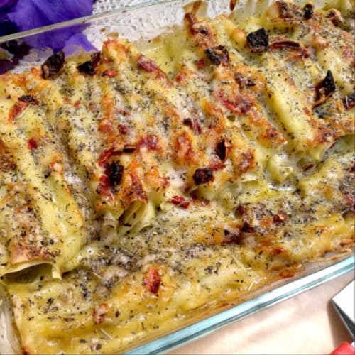 Fresh cannelloni with pesto with vegetables and Persian cherry tomatoes