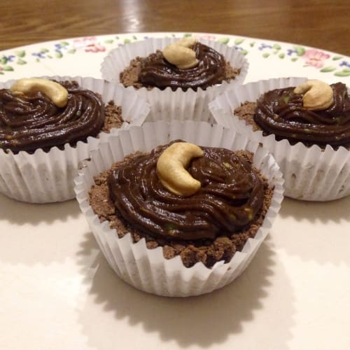 Cocoa cupcakes stuffed with peanut butter with avocado topping