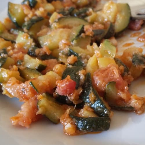 Tasty zucchini in pan
