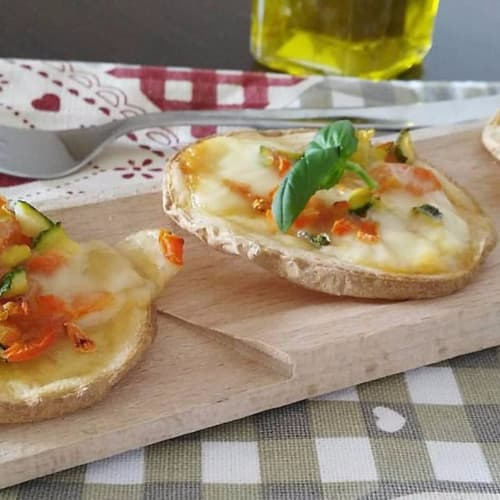 Potato pizza with vegetables and scamorza