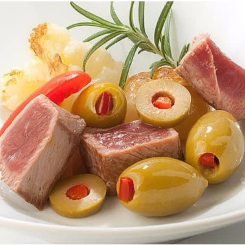 Fillet with olives stuffed with pepper
