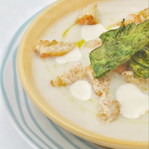 Cream of cauliflower with parmesan cream, black cabbage chips