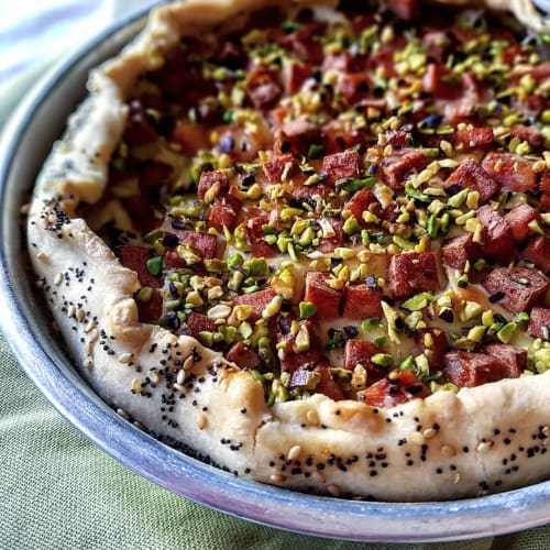 Rustic pie with mortadella and pistachio