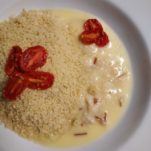Tasty couscous with smoked provola cream and smoked tomato