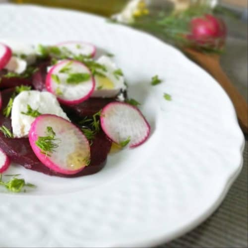 Cut of red turnip with goat cheese