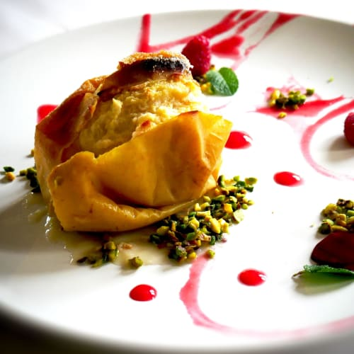 Apple cooked with Pistachios and Raspberries