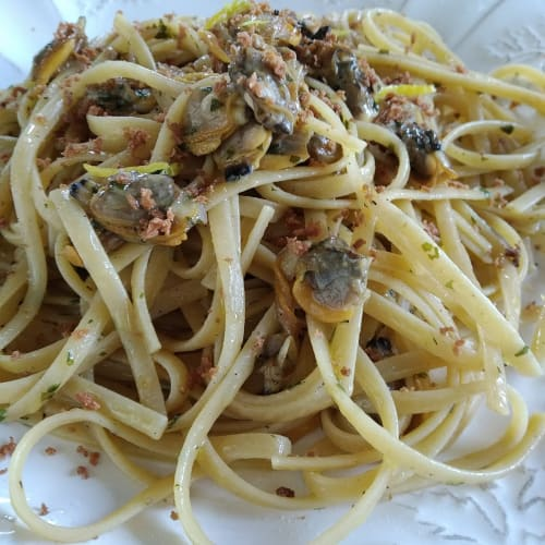 Linguine pasta with clams, bottarga and lemon zest
