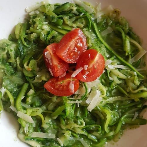 Zucchini spaghetti with rocket pesto and almonds