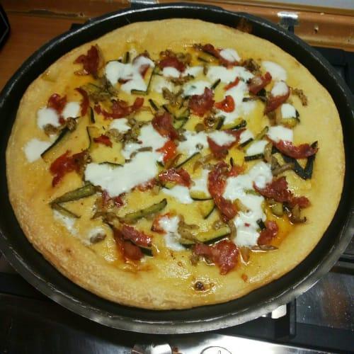 Pizza in baking tin