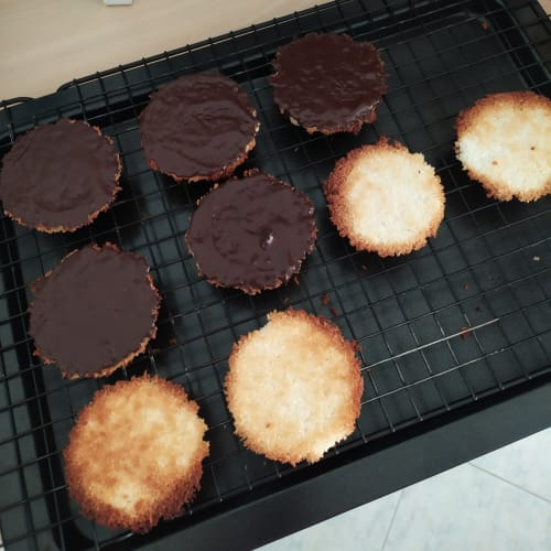 Coconut biscuits with dark chocolate topping