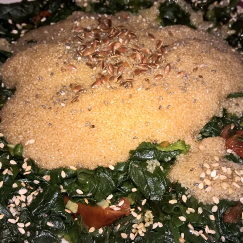 Amaranth and spinach with sundried tomatoes and various seeds