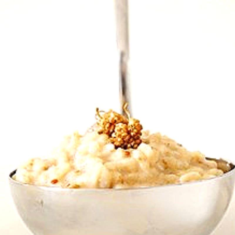Risotto alle more di gelso con burro di mandorle
