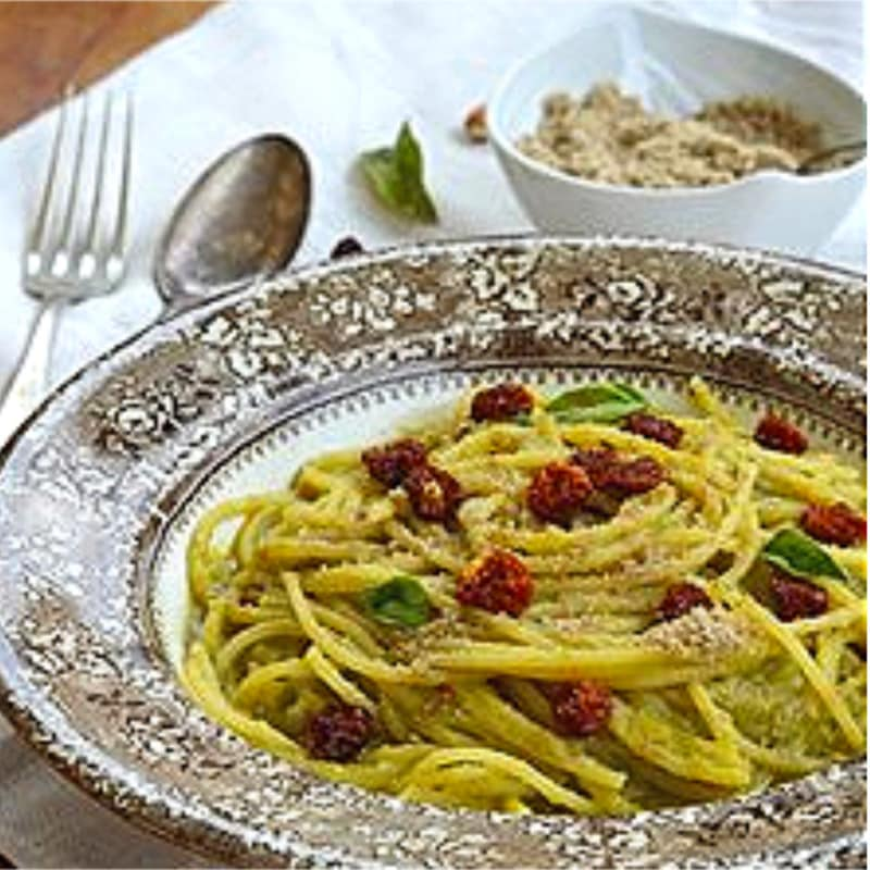 Spaghetti with zucchini cream and berries physal