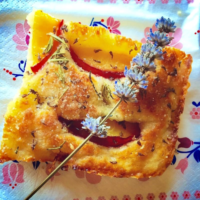 Focaccia with peaches rosemary and lavender flowers