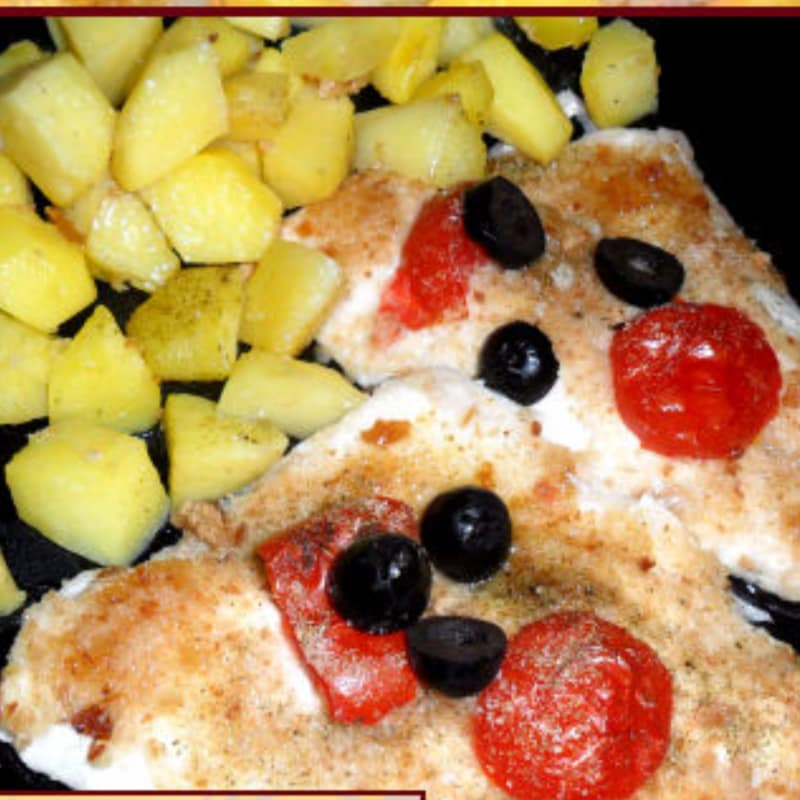 Fillets of sea bream baked au gratin with tomatoes, olives and potatoes