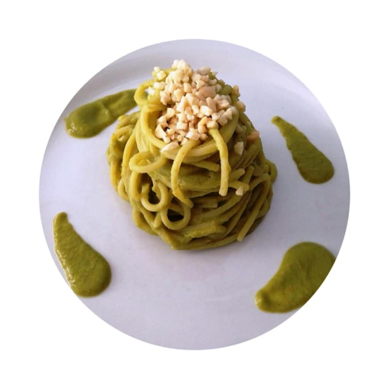 kamut spaghetti in cream of peas and chopped almonds