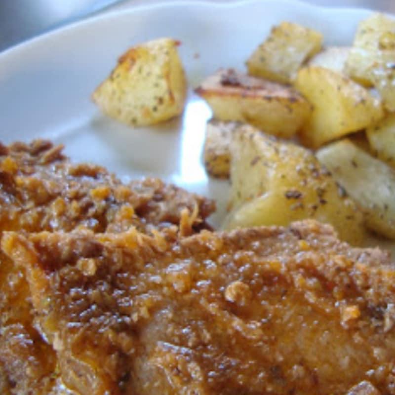 Asada con las patatas cocidas al horno