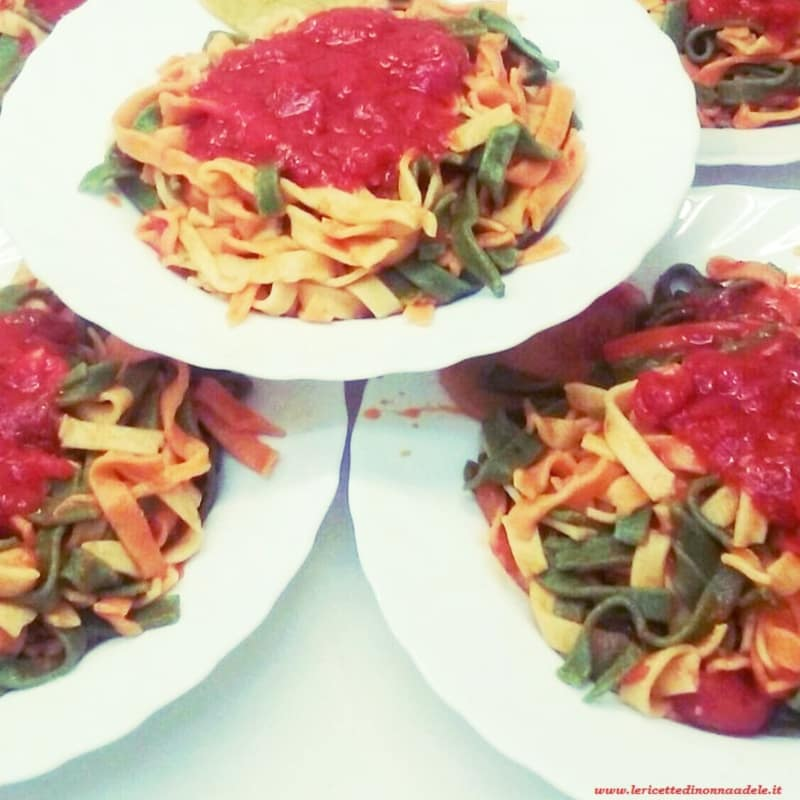 multicolored tagliatelle with fresh sauce