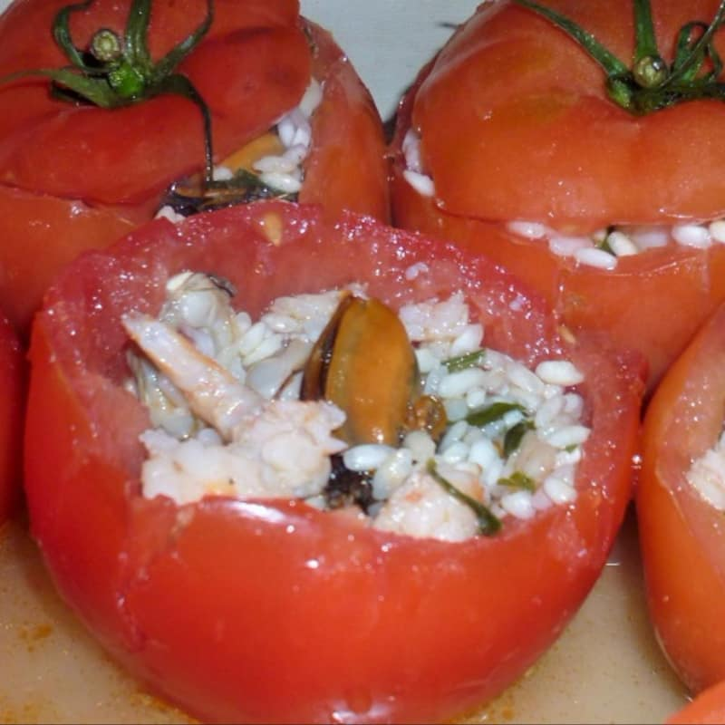 Tomatoes stuffed with rice and seafood
