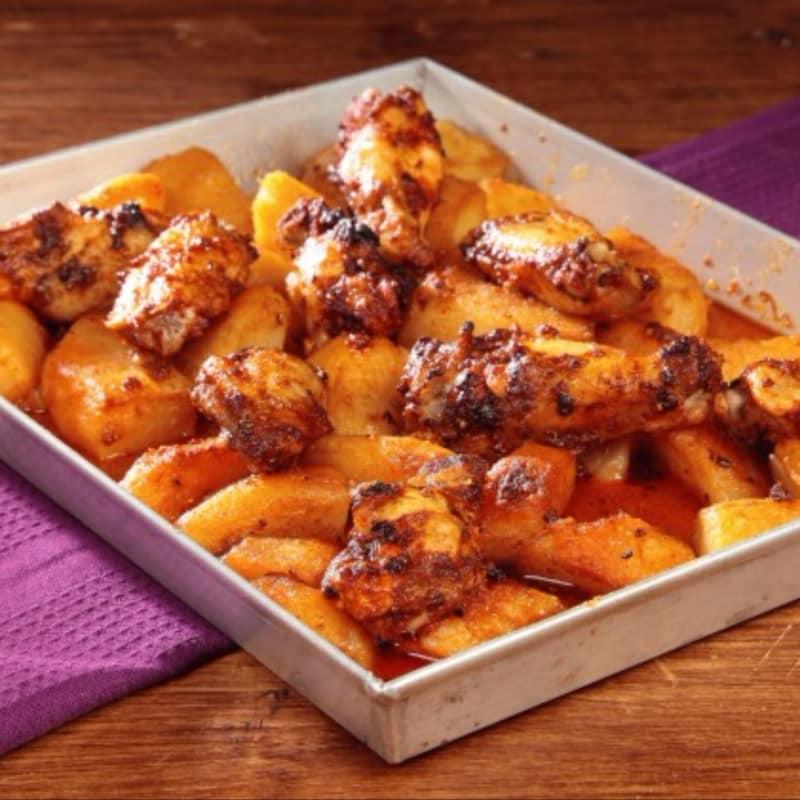 alitas de pollo con papas fritas a México